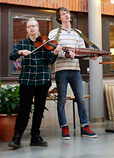 "Musicians in the ""Lunnekvintetten"" folk music troupe performing at the library."