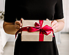 Woman with nicely wrapped present. Photo: Istockphoto