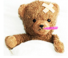 Sick Teddy bear with Thermometer in its mouth
